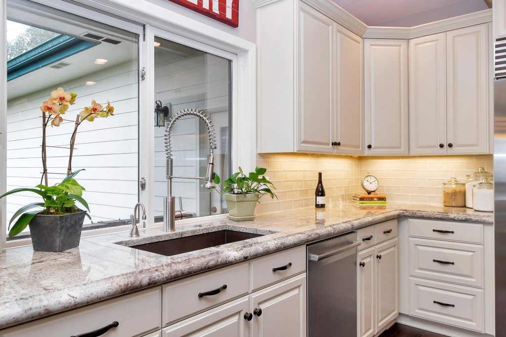 Granite countertops with high end white glass subway
